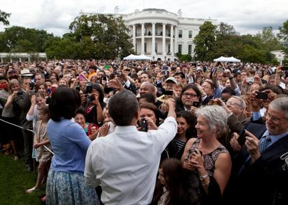 Barack and Michelle Obama with White House visitors